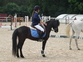 Entrenadora de caballos de salto